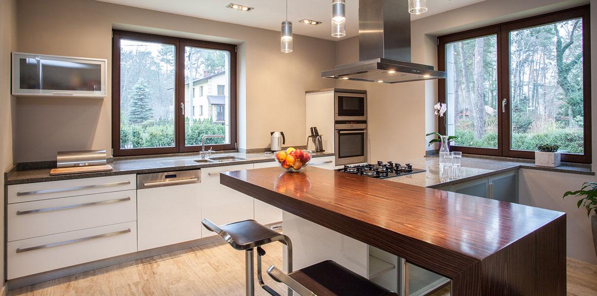 Jarso cocinas puertas encimeras taburetes mesas for Cocinas modernas con islas centrales