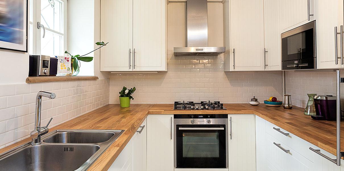 Jarso cocinas puertas encimeras taburetes mesas for Barras de cocina para espacios pequenos